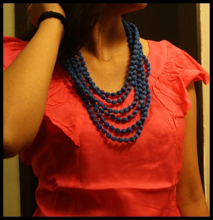Short blue pom pom necklace