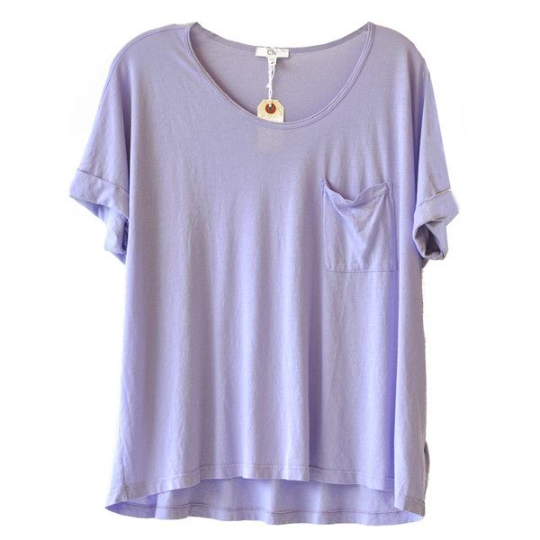 """Loose fit give a whimsical feel to a simple lightweight tee. Scooped neckline. Rolled sleeves. Single pocket detailing. 50% Cotton 50% Modal. Measures 19"""" from…"""