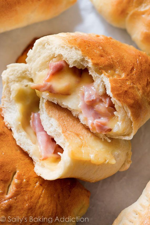 Make freezer-friendly homemade ham & cheese pockets with this easy recipe! Quick to reheat on the go! sallysbakingaddiction.com