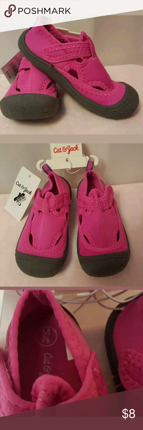 Cat&Jack Toddler Girls Cass Pink Water Shoes 7/8 M IToddler Girls' Cass Water Shoes Pink - Cat & Jack™. These toddler girls' water shoes will keep her feet protected while she plays in the water.  Great for the beach, splash pad, water park, or pool days.  Polyester construction for durability and comfort  Slip on water shoe with Velcro strap  Soft pink fabric  Thick rubber sole for traction  Wipe clean as needed to maintain quality Cat&Jack Shoes Water Shoes