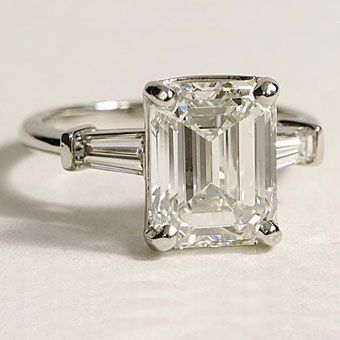 platinum ring with tapered baguettes and emerald-cut center stone, $2,800 (without center stone)