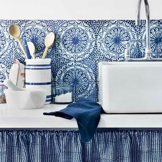 "lovely blue and white tiny check cabinet curtain matches Mexican tile backsplash.  Link: ""40 Awesome Kitchen Backsplash Ideas"""