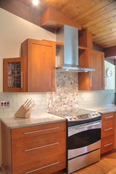 Shaker Kitchen  Stainless Steel Appliances, Multi Tiered Wall Cabinets,  Custom Tile Backsplash, Counter Height Seating For Shaker Door In Cherry,  ...