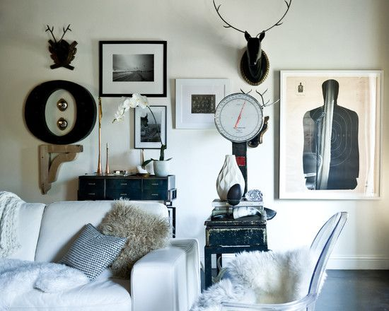 the three frames between the O and the antlers work as a small group of 3 | houzz