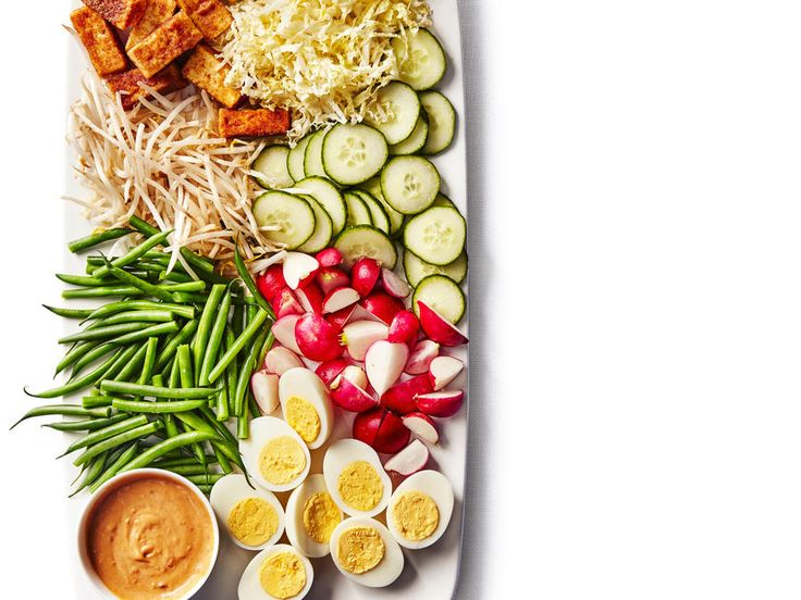 "A popular street dish in Indonesia, gado gado (""mix-mix"") is just the thing to shake up your weeknight routine. Hard-cooked eggs, toasted..."