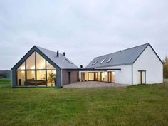 Modern barn home - love the positioning of the 2 sections joined.