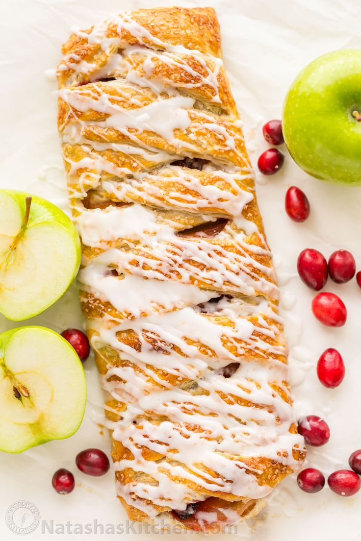 An Apple Danish Braid loaded with juicy caramelized apples and cranberries in a flaky pastry shell. This braided apple danish is easy and disappears fast! | natashaskitchen.com