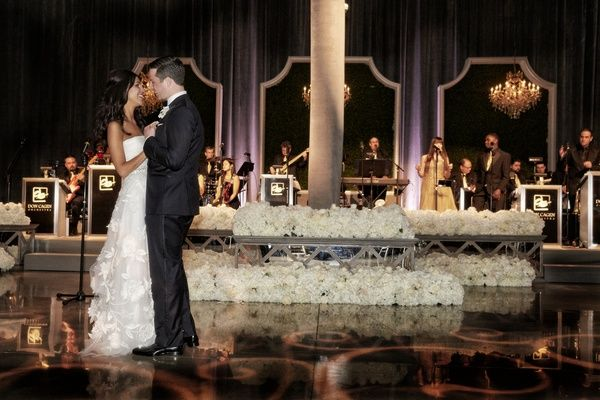 First Dance in Front of Live Band    Photography: KingenSmith   Read More:  http://www.insideweddings.com/weddings/modern-jewish-wedding-with-unique-details-and-deep-color-palette/929/