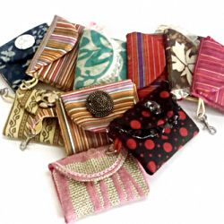 Credit card holder with easily accessible pockets, snap closure, stylish flap cover & a trigger clip to attach your keys or to your purse