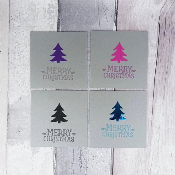 These mini handmade silver Christmas cards are 4 inches wide and 4 inches tall and feature a Christmas tree (Xmas tree) embellishment in either pearlescent or foiled card with a selection of messages and colours for you to personalise your cards.  The message on the front of the card is hand stamped with same colour ink to match the Christmas tree embellishment.  These cards are available in packs of 6 or 12, with an additional saving on the 12 packs.  PERSONALISING YOUR CARDS: You can…