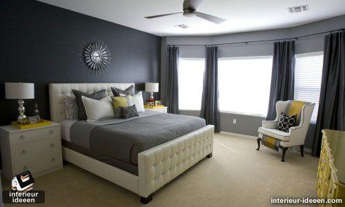 grijze slaapkamer met gele tint