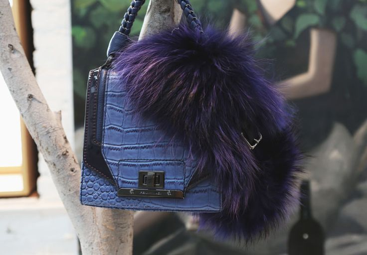 Blue: relaxed, endless and regal. For winter is the new black. #pennyblack #ny #furcollar #bluebag