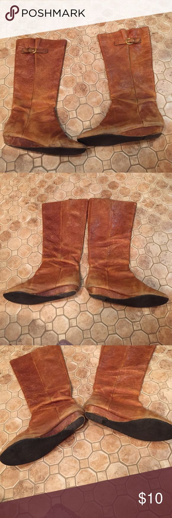 Steve Madden Cognac Intyce Riding Boots Steve Madden Intyce riding boots in cognac color. 1 inch wedges heel and side buckles. These are well loved and the sole should be replaced, as the heel is wearing out. Perfect for someone handy or willing to invest in a shoe repair to fix these. 100% Leather with suede lining inside. Steve Madden Shoes