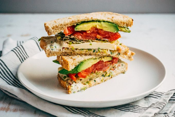 California Sandwich  slices multigrain bread buttermilk ranch dressing 2-4 slices Monterey Jack cheese 1 large tomato, cored and sliced 1/2 cup sprouts, rinsed well and blotted dry 1 avocado, sliced sea salt