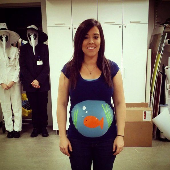 19 Creative Costumes For Expectant Mamas A Fish Bowl Create this simple but adorable idea by painting a blue shirt with a sweet fish and layer it with another top that has a hole cut for your bump.