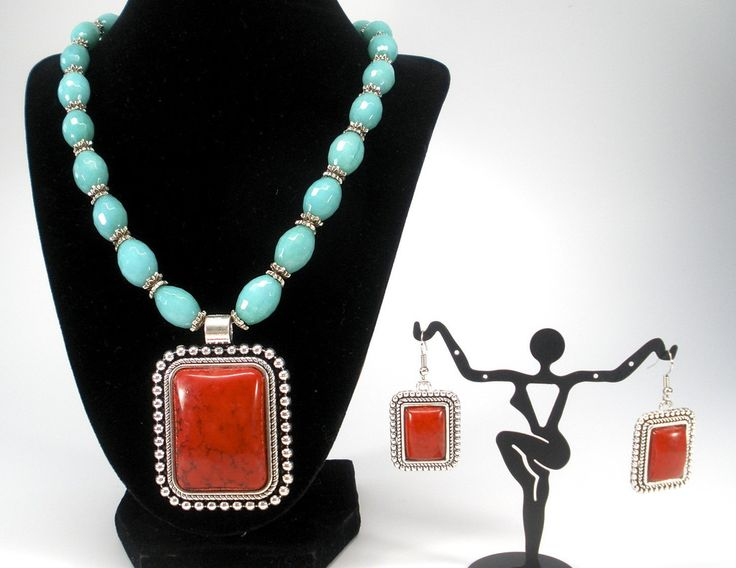 trendy semi precious set with oval beads and red stones