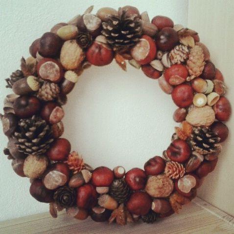 Autumn wreath made of conkers (chestnut), pinecones, acorns and nutshells.