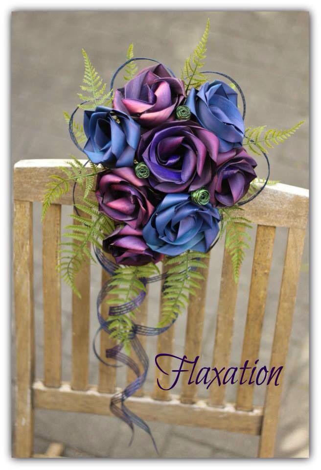 Waterfall bouquet in purple & sapphire blue with green fern.                 www.flaxation.co.nz