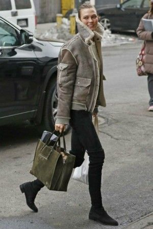 Karlie Kloss wearing Stuart Weitzman Lowland Boots, Balenciaga Papier A4 Suede Tote and Brock Collection Shearling Collar Jacket