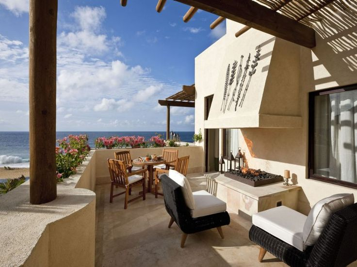 """CAPELLA PEDREGAL, CABO SAN LUCAS  Los Cabos, Mexico    Our readers say: From the moment they make their dramatic entrance through a 1,000-foot torch-lit tunnel, guests say that this property designed to emulate a Mediterranean mountainside village is """"a real nirvana."""" Interiors celebrate traditional Mexican culture, with indigenous plants and stones, handcarved wood, local artisan-made ceramic tiles, and desert-inspired hues."""