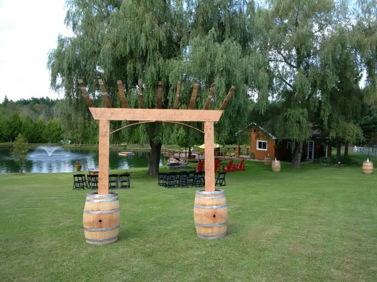 Wedding arbor .made from retired wine barrels an old barn beans available for rent