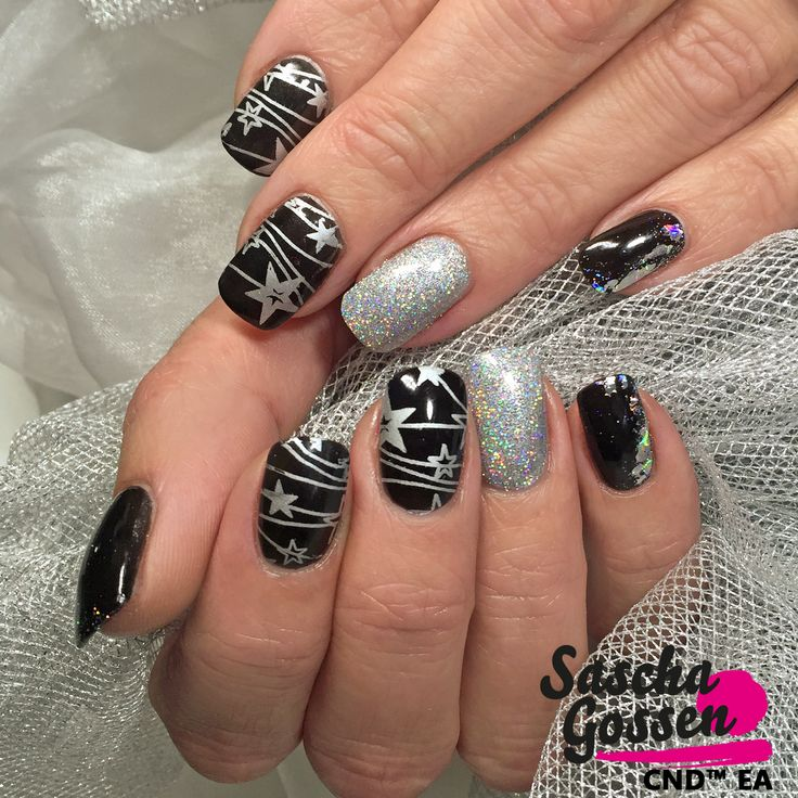 Countdown for Christmas! ⭐️ With CND™ SHELLAC™ Black Pool, Silver Chroom, foil, Lecenté glitters and the :YOURS loves SASCHA stampingplate. #instanails #instanails #inspiration #creative #stampingnailart #cnd #cndworld #cndshellac #shellac #style #stamps #stampingplates #saschagossen #saschagossencnd #yourscosmetics #yourslovessascha #Lecenté #laprofilique #glitter #christmas #christmasnails #stars #nails #nailart #naildesign #nailtech #nailpro @yourscosmetics @cndworld @lovelecente