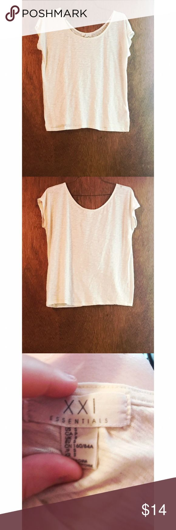 Forever21 Cream Short Sleeve Top Forever21 Cream Short Sleeve Top in size small. Small tear on the seam of the right shoulder - pictured. Can probably be sewn easily. I'm just not very skilled at sewing personally. Barely noticeable, and would never be seen if you have long hair and wear it down. Very cute and in perfect condition otherwise! Price reflects and feel free to ask any questions you may have. Offers welcome! Forever 21 Tops Tees - Short Sleeve