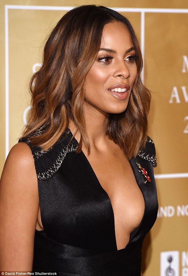Daring: Rochelle Humes, 26, continued to flaunt her style prowess as she went braless in a plunging gown for the Music Industry Trust Awards (MITS) at the Grosvenor House Hotel in London on Monday night