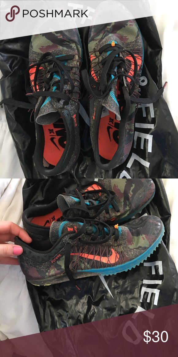 NIKE cross country running spikes Only worn a few times. New condition Nike Shoes Athletic Shoes