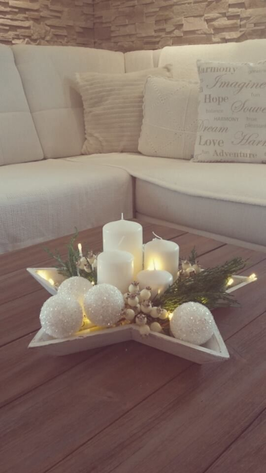 Pink candles with flowered peels, orange slices and candlelight oranges: