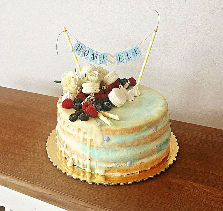 Birthday cake in white and blue colour combination. Birthday cake for boys.
