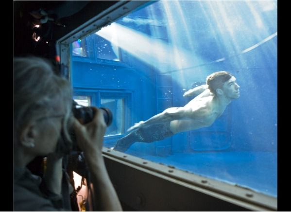 Merman - Photographer Annie Leibovitz shoots Michael Phelps, who posed as a merman in Julianne Moore's photo of Ariel from The Little Mermaid.