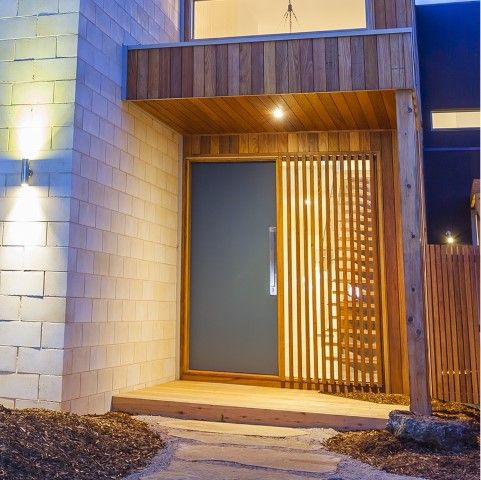 A solid core timber door has been used with the feature being the clear glass panel beside with feature timber. Contemporary door hardware has been used - Gainsborough Omni Allure pull handle + trilock internal (Brushed satin chrome).