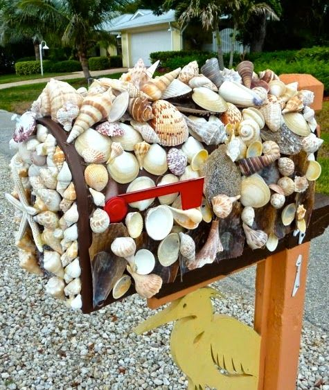 Mailbox decorated with Sanibel Shells. Featured on CC:   http://www.completely-coastal.com/2014/07/coastal-nautical-unique-mailboxes-mailbox-art.html