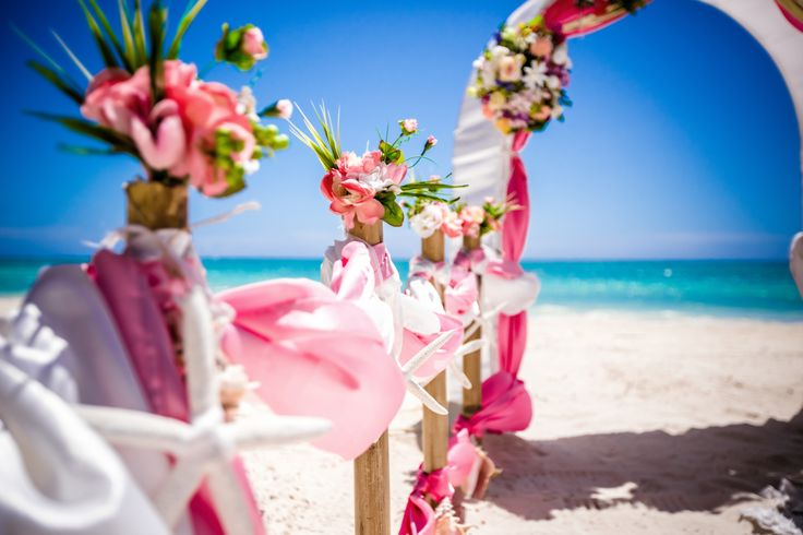 Gorgeous pink and white wedding ceremony arch decoration by www.wedding-caribbean.com Photo by Nik Vacuum.