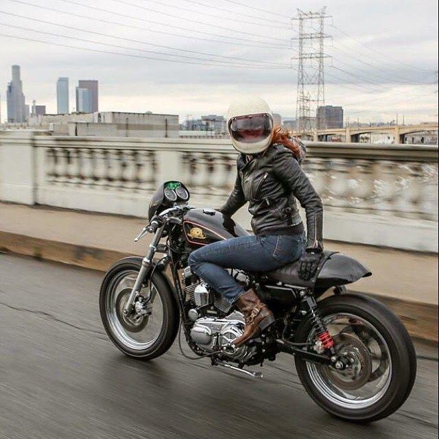 Harley-Davidson Sportster cafe racer with girl rider going over LA river bridge downtown #harleydavidsonsportsterwomen