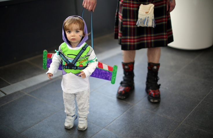 Three-year-old Tristan Ellis went to the MCM Midlands Comic Con Expo dressed as Buzz Lightyear with his father. (Image via Christopher Furlong/Getty Images).