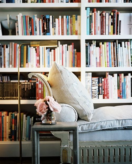 An abundance of books and a cozy place to read