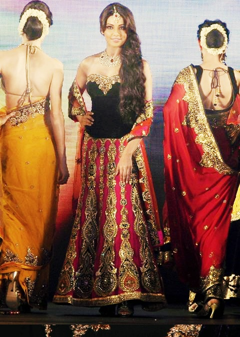 Bipasha's lengha features gold embellishments and brocade, two must need details in Indian clothing!