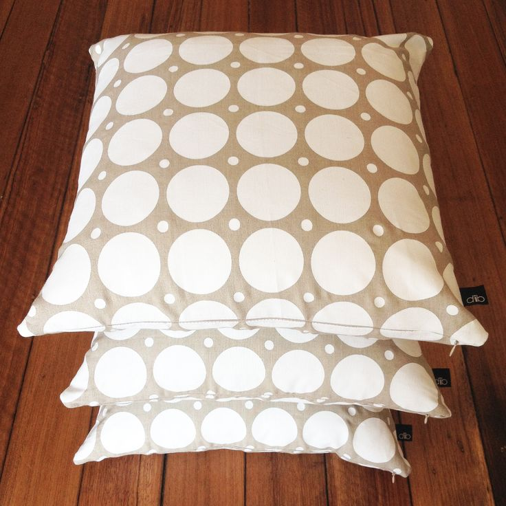 Double dot white on natural linen cushions.