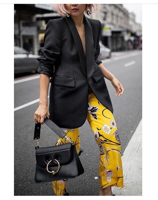 have some fun with yellow printed pants and a black blazer