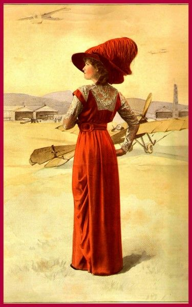 1912 – Vivid Orange for the visit to the Aeroport showing aeroplanes as an unusual backdrop for this Laferrière gown.