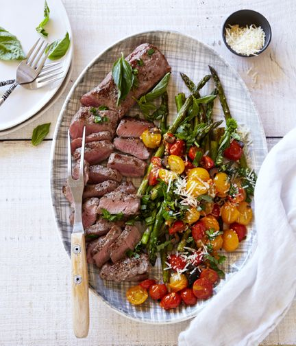 Grilled Lamb with pan roasted asparagus, olives, and tomatoes. Meal delivery service from farm to front door from Terra's Kitchen.