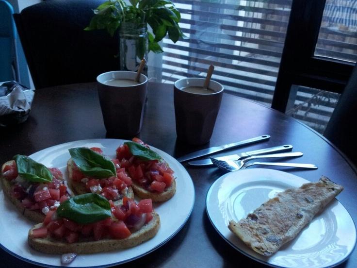 Bruachetta, fried egg and coffee for breakfast.