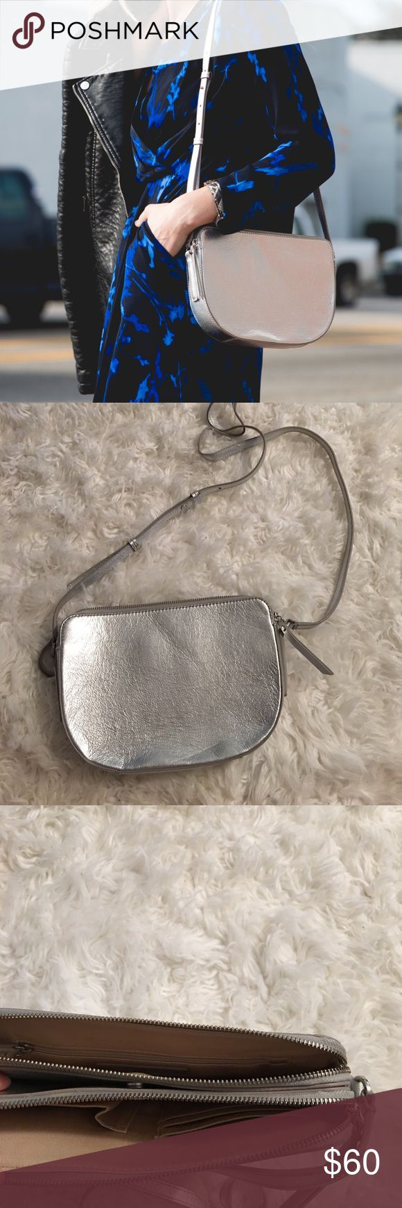Banana Republic silver half moon cross-body Like new (worn once for a photoshoot) Banana Republic silver half moon cross-body bag with 6 pockets, credit card pockets and a phone pocket. Banana Republic Bags Crossbody Bags