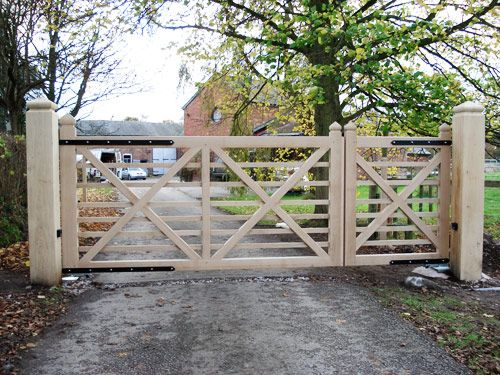 Consider this design with rusted iron = horizontal bars would blend with fencing, x's add some character