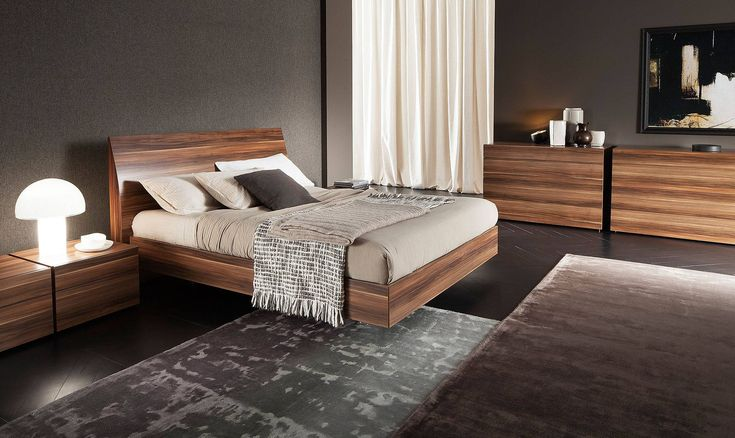 Dual colored wooden contemporary bedroom set in walnut. This bedroom group combines classic two-toned wooden finish with contemporary shapes. The classic collection sports modern geometric lines, making it a neat update to any bedroom. An elegant contemporary choice, the warm walnut bed is the perfe...