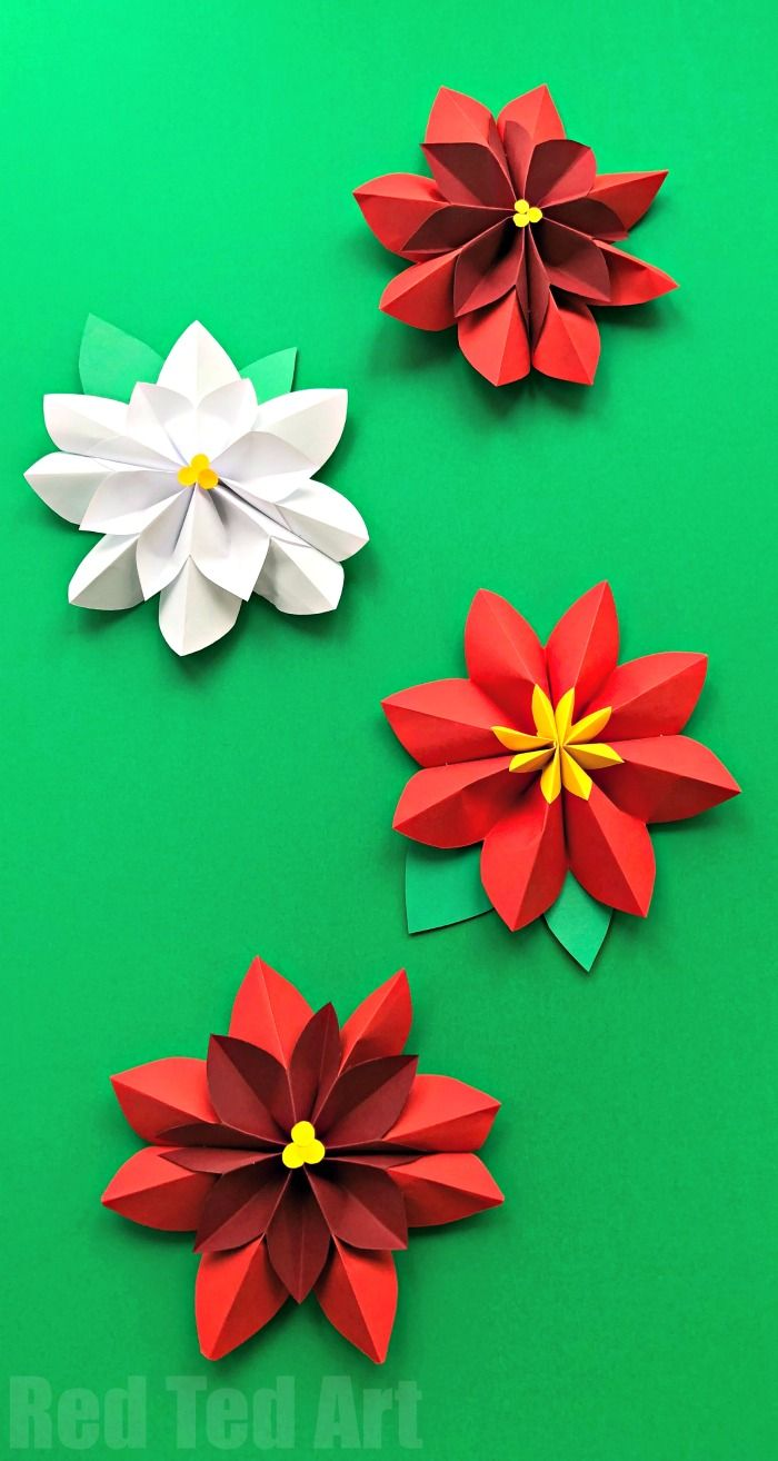 Super pretty 3D Paper Flowers Poinsettia - a gorgeous Christmas decoration. Love how you need just paper to make these beautiful 3D Giant Poinsettia Flowers