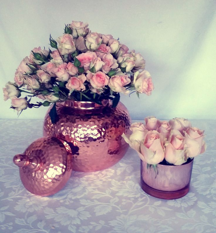 Soft pink roses in rose gold containers for the Elie Saab Perfume stand