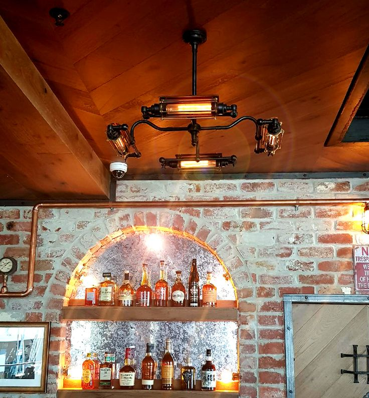 Four cage horizontal tube pendant pictured insitu at the Loose Moose.